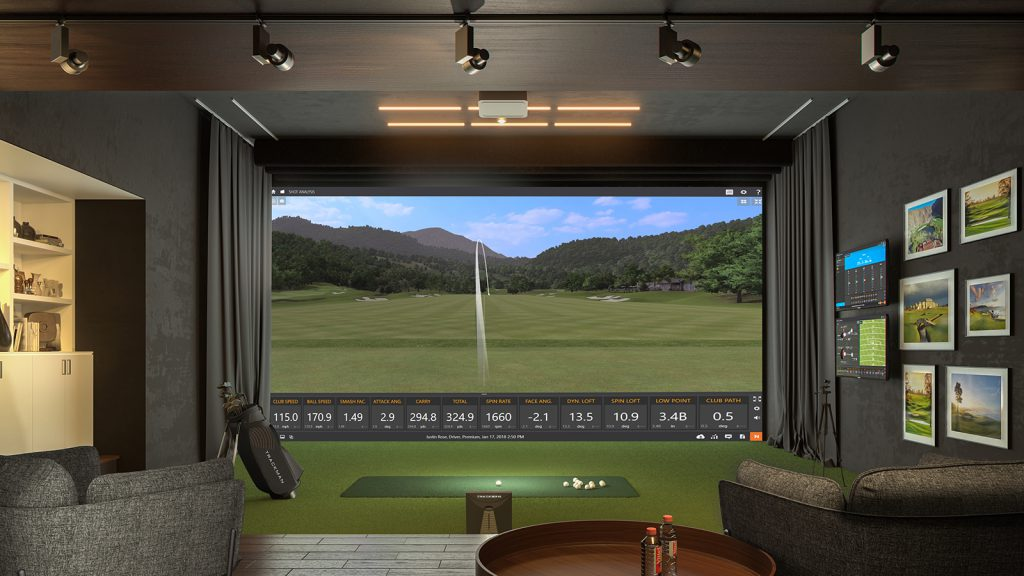 two chairs look towards a large screen showing the trackman indoor golf technology
