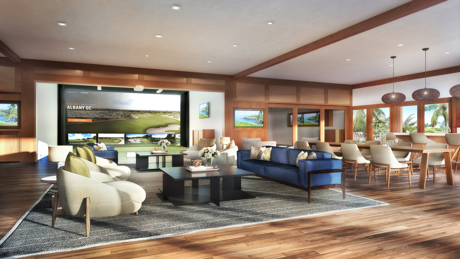 Lounge at Golf Academy with a blue couch, beige chairs, a large screen TV and table with chairs looking over golf club